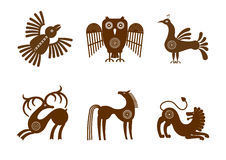 Set of stylized graphic images of animals in tribal style. Set of stylized graphic of brown images on a white background in tribal style with a small number of Stock Image