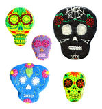 Set of sugar skulls. Handmade naive Day of the Dead symbol. Stock Photography