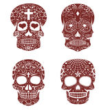 Set of sugar skulls isolated on white background. Day of the dea Stock Images