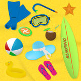 Set of summer beach items. Diving, surfing and vacation items located on a sand background. Stock Images