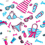 A set of summer clothes and accessories. Beach bag, hat, flip flops, dress, swimsuit, cocktail, glasses and tanning agents. Vacati Stock Photo