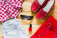 Set of summer clothes for women. On the floor royalty free stock photo