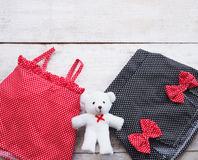 Set summer dress of girl kids and teddy bear Royalty Free Stock Image
