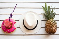 Set of summer. Pineapple hat and drink, top view from above Royalty Free Stock Images