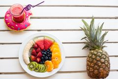 Set of summer. Fresh fruit plate, pineapple and drink, top view from above Royalty Free Stock Images