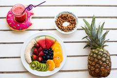 Set of summer. Fresh fruit plate, pineapple and drink, top view from above Royalty Free Stock Image