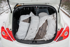 Set of summer tires. full trunk  white hatchback in a forest Stock Image