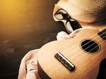Set of summer vacation. Ukulele with sunglass and hat. Relaxing item for rest and take a break. Sepia and vintage color tone with dark vignette Stock Photography
