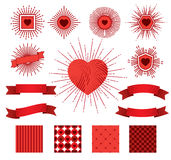 Set of sunburst, hearts, ribbons and patterns for celebrating Valentines Day. Stock Photo