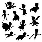 Set of superhero silhouttes. Collection of silhouettes of children dressed as super heroes, isolated on a white background stock illustration