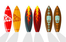 Set of  surf boards. With Hawaiian patterns and flames Royalty Free Stock Photos