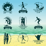 Set of Surfing club logos. Symbols or icons on background with a beach Stock Photography