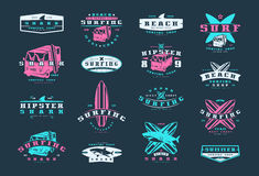 Set of surfing emblems. Graphic design for t-shirt. Color print on black background Royalty Free Stock Photos