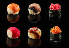 Set of sushi balls and maki rolls. Over black background stock images