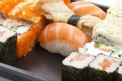 Set of sushi in black plastic box Stock Images
