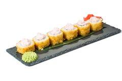 Set of sushi on black slate substrate, isolated Stock Images