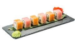 Set of sushi on black slate substrate, isolated Royalty Free Stock Photography