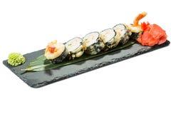 Set of sushi on black slate substrate, isolated Stock Photo