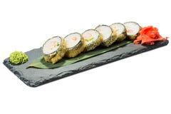 Set of sushi on black slate substrate, isolated Stock Photography