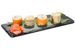 Set of sushi on black slate substrate, isolated Stock Photos