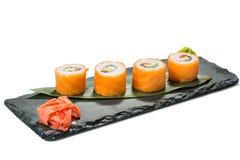 Set of sushi on black slate substrate, isolated Royalty Free Stock Photos