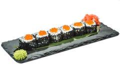 Set of sushi on black slate substrate, isolated Royalty Free Stock Photo