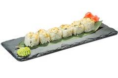 Set of sushi on black slate substrate, isolated Royalty Free Stock Image