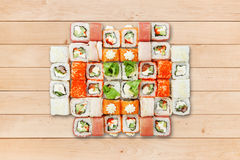 Set of sushi california rolls at wood. Stock Image