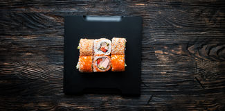 Set of sushi with caviar and sesame on black tray Stock Photography