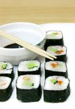 Set of sushi and chopsticks. Partly isolated over white Stock Image