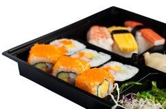 set sushi för svart ask Arkivfoton