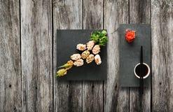 Set of sushi gunkan at wood. Royalty Free Stock Photo