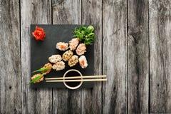 Set of sushi gunkan at wood. Royalty Free Stock Photography