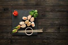 Set of sushi gunkan at wood. Royalty Free Stock Images