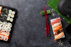 Set of sushi, maki and green tea royalty free stock photo