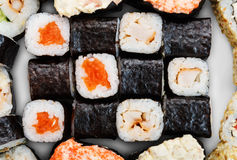 Set of sushi, maki, gunkan and rolls with salmon Royalty Free Stock Photo