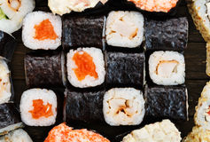 Set of sushi, maki, gunkan and rolls with salmon Royalty Free Stock Photo