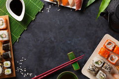Set of sushi and maki roll and green tea Stock Photos