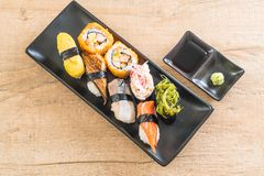 Set of sushi and maki roll. Japanese food style stock photos