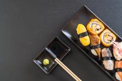 Set of sushi and maki roll. Japanese food style royalty free stock image