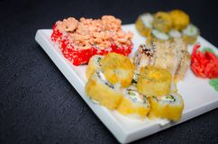 Set of sushi and maki roll on stone table. Top view with copy space Royalty Free Stock Images