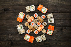 Set of sushi maki and rolls at black rustic wood. Stock Image