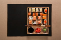 Set of sushi maki and rolls in carton delivery box Stock Image