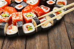 Set of sushi, maki and rolls  closeup with chopsticks Stock Photography