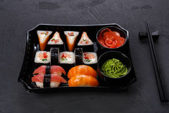 Set of sushi maki and rolls closeup in delivery box Stock Photos