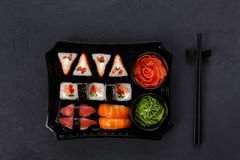 Set of sushi maki and rolls closeup in delivery box Royalty Free Stock Photos