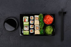 Set of sushi maki and rolls closeup in delivery box Stock Photography