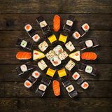 Set of sushi, maki and rolls  at wood Royalty Free Stock Photography