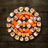 Set of sushi, maki and rolls at wood. Japanese food restaurant delivery - sushi maki california roll platter set at wooden background, above view royalty free stock photos