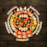 Set of sushi, maki and rolls  at wood Royalty Free Stock Photo